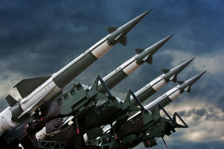 ballistic: Antiaircraft  rockets on the launcher against dramatic sky.