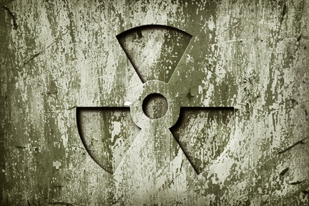 nuke: A nuclear sign on grunge  metal door. Stock Photo