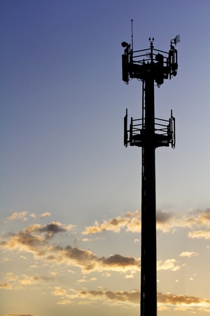 Silhouette of GSM transmitter tower at sunset. Stock Photo - 10281139