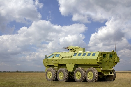 A military armored vehicle on the field. photo