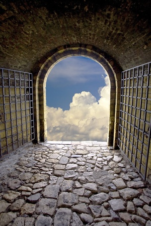 escape: old stone tunnel with exit gate like a symbol of hope.