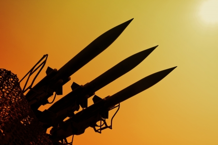 missiles:  Silhouette of antiaircraft defense rockets . Shadows of the war.