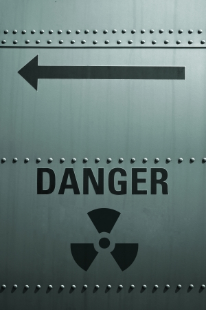 Sign of radioactive danger on the metal wall. photo
