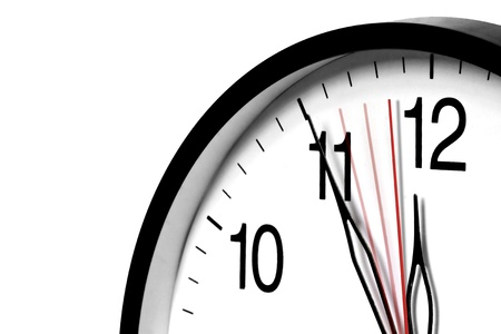five to twelve: Wall clock  ,5 minutes to twelve and still ticking  Stock Photo