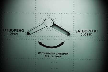 doorhandle: Aircraft door background with  English and Bulgarian descriptions. Stock Photo