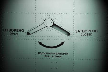 steel door: Aircraft door background with  English and Bulgarian descriptions. Stock Photo