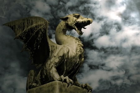 myth: Dragon on the stone over dramatic sky. Symbol of Ljubljana