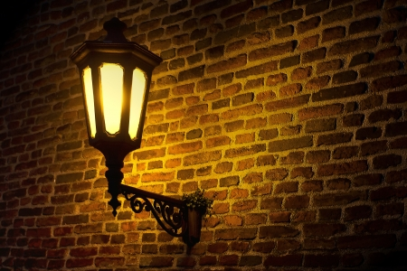 Street lantern on a wall at dark night
