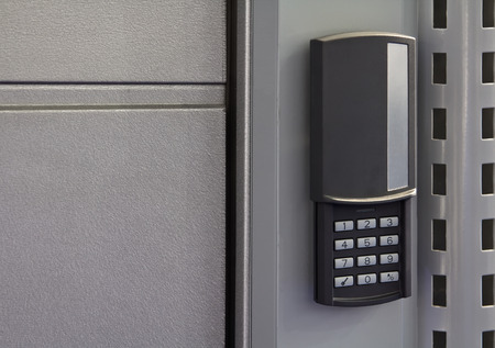 An electronic lock on metal front door. photo
