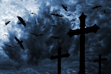 cemetery: Ravens over the cemetery under a dramatic night sky Stock Photo