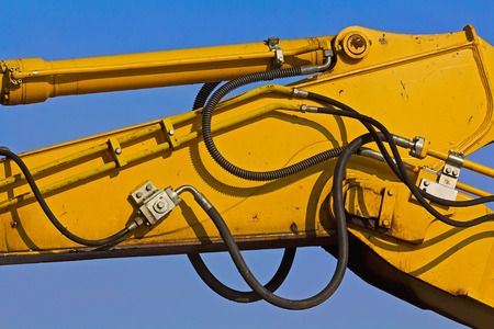 hydraulic hoses: Crane detail on a blue sky background