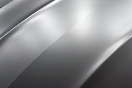 silver sports car: Surface of silver sports car hood. Stock Photo
