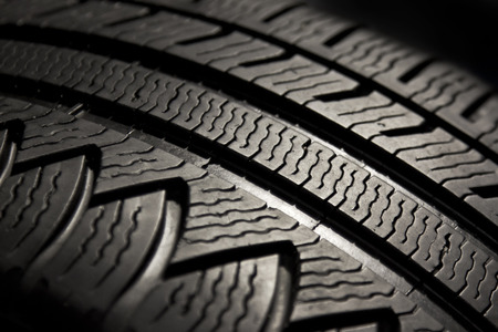 traction: Macro view on pattern of a car tire.