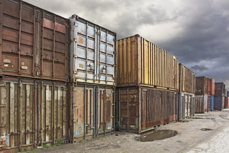 merchandize: Old rusty truck containers in the cargo zone. Stock Photo