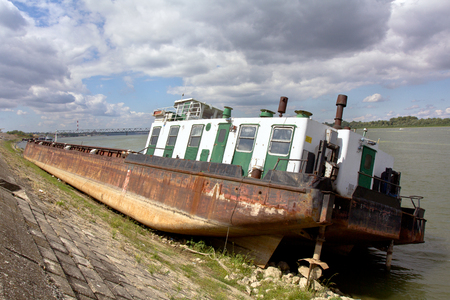 beached: beached cargo ship on the river bank.
