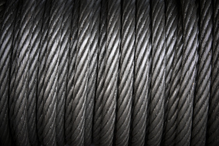 background with a coiled steel cable.