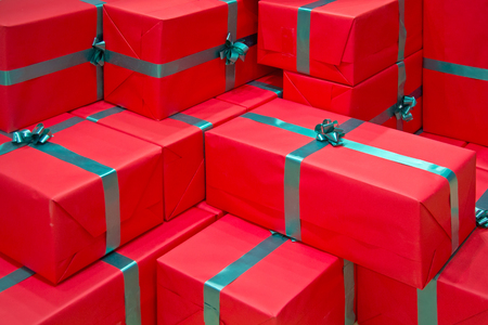 gift boxes: background made of red gift packages Stock Photo
