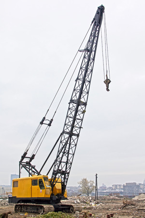 Crane truck on the construction site.