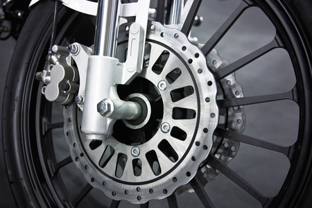 screw jack: a wheel of a motorcycle with disk brake