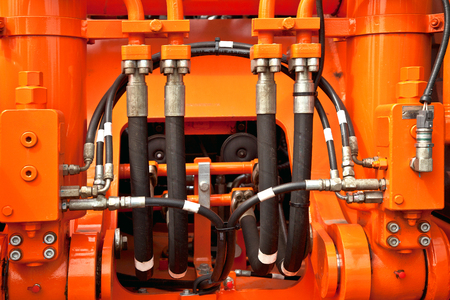 Hydraulic pressure pipes on construction machinery.