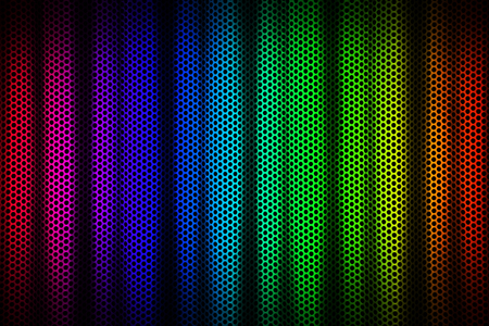 Color spectrum on perforated metal with shadows Stock Photo