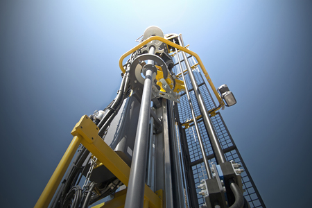 Hydraulic crawler drill machine against blue sky. Stock Photo