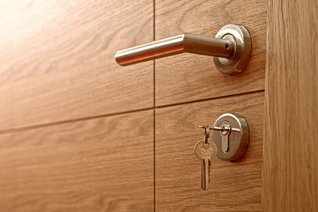Close-up of the lock with  key on a door.  Stockfoto