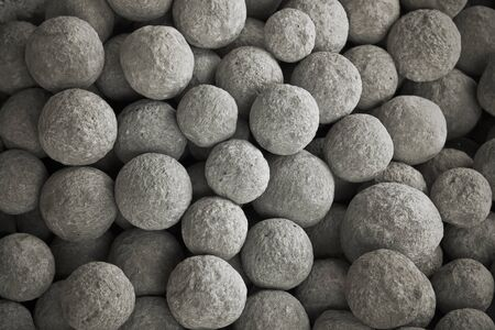 Collection of  ancient stone cannon balls