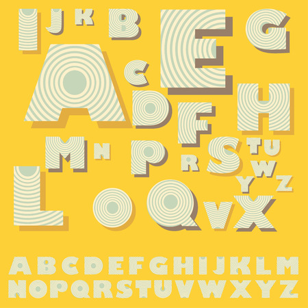 diffusion: decorated alphabet with concentric circles pattern in soft blue and yellow