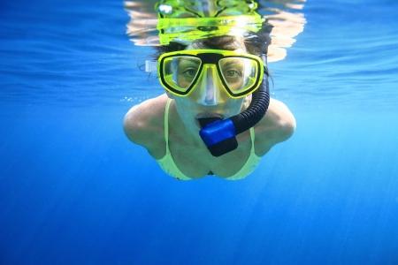 Woman snorkeling in the blue Standard-Bild