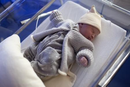 childbearing: Newborn in baby bed in childbearing