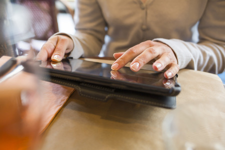 Female digital tablet computer bar restaurant
