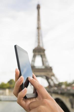 cell phone tower: Close-up hand Female mobile phone Paris seine bridge message sms e-mail