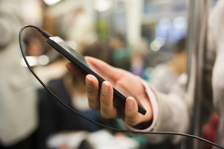 Female smartphone hand underground Imagens