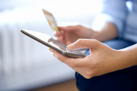 mobile commerce: woman is shopping on the internet with mobile phone, ecommerce Stock Photo