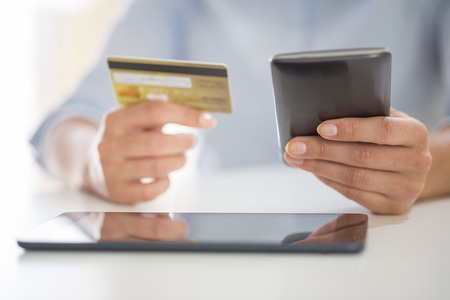 woman is shopping on the internet with mobile phone, ecommerce Imagens