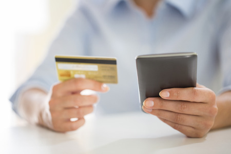 woman is shopping on the internet with mobile phone, ecommerce Foto de archivo
