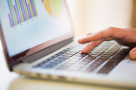 Woman working on financial data with computer