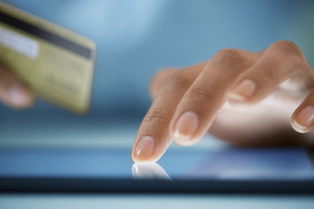 Close-up hand Woman shopping online with digital tablet