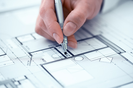 Female pencil blueprint pen hands closeup Standard-Bild