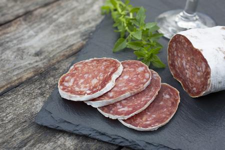 slate: Slices of salami on natural wooden
