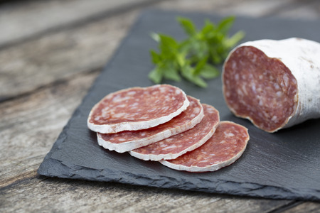 Slices of salami on natural wooden