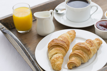 French breakfast with croissants, coffee and orange juice photo