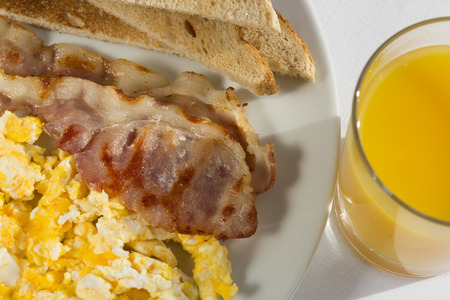 bacon and eggs: Sunny Breakfast with bacon, eggs and bread.