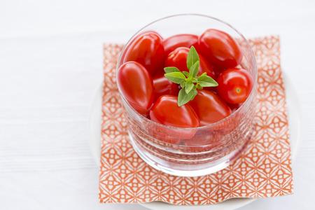 Fresh cherry tomatoes in glass bowl