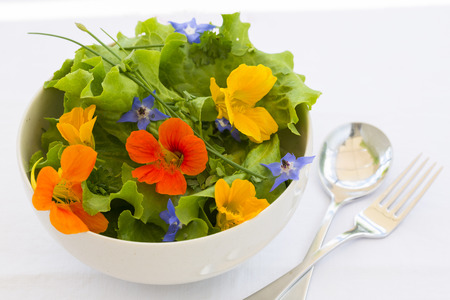 Summer fresh flowors salad in bowl Stock Photo