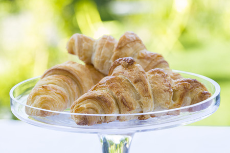 French Croissants on glass dish Imagens