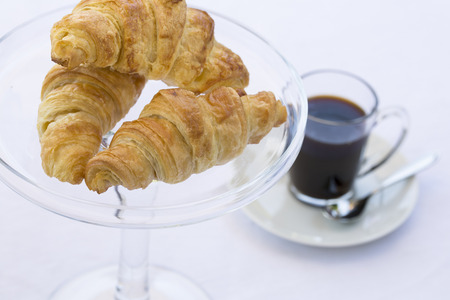 French Croissants on glass dish with coffee
