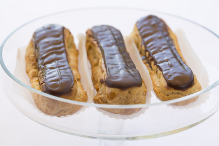 Delicious French Chocolate eclairs on plate