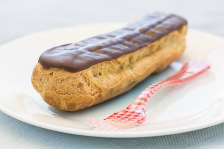 chocolate sweet: Delicious French Chocolate eclairs on plate